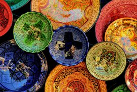 View from above looking down on colorful bowls of various sizes and styles
