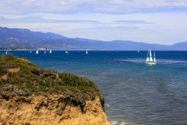 A view of sailboats on the ocean just off the coast of Santa Barbara