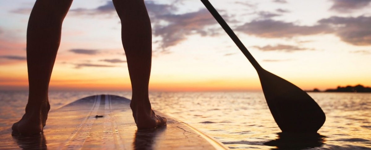 Paddleboarding at sunset on the ocean